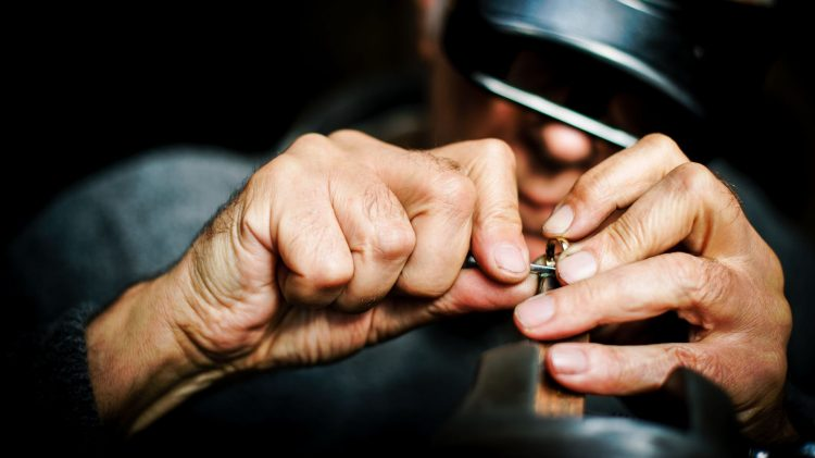 man crafting jewellery